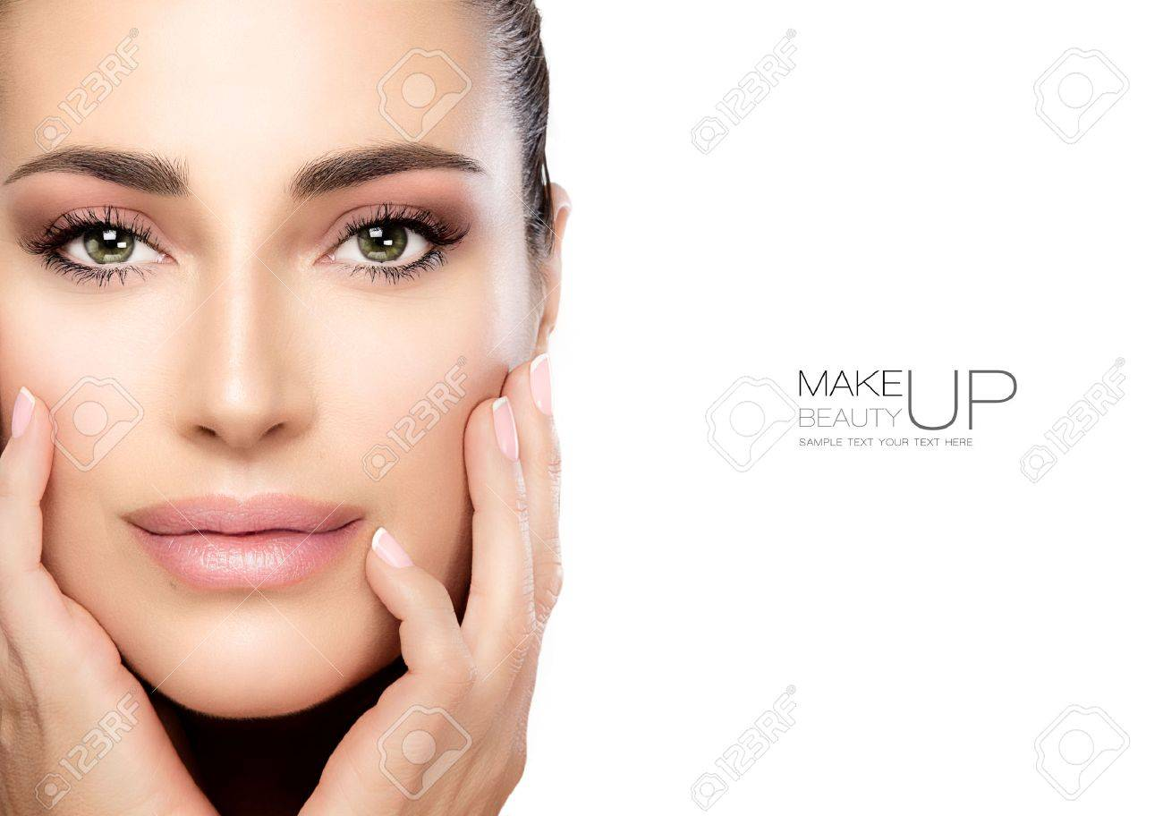 Beauty Makeup and Nai Art Concept. Beauty model woman with soft pink smoky eye makeup, foundation on a unblemished skin and trendy pink lipstick to match her manicured nails. High fashion portrait isolated on white with copy space for text - 69242185