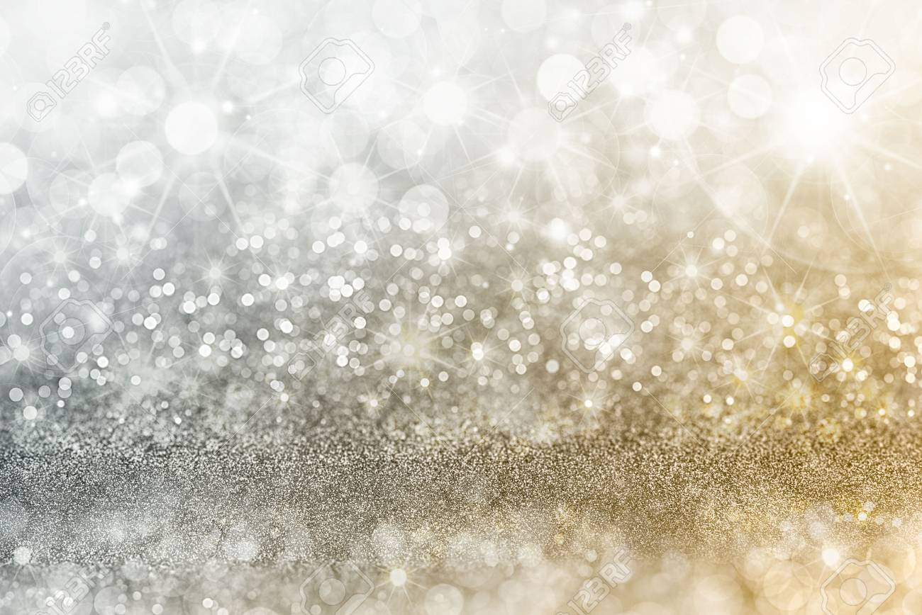 Silver and gold Christmas background with graduated bands of different sparkling and twinkling bokeh from party lights and glitter, full frame copyspace - 69713891