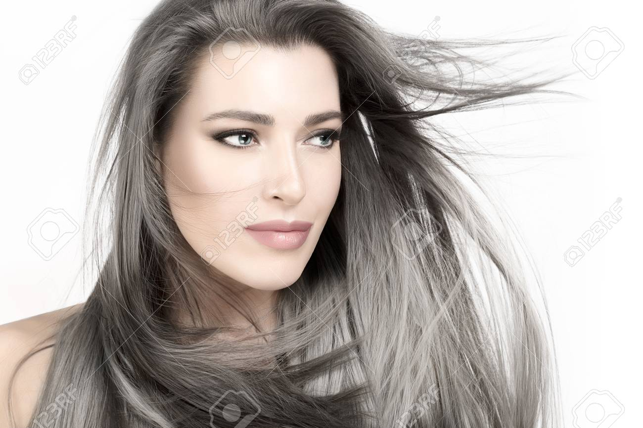 Attractive young woman with long trendy silver hair blowing in a breeze. - 118905056
