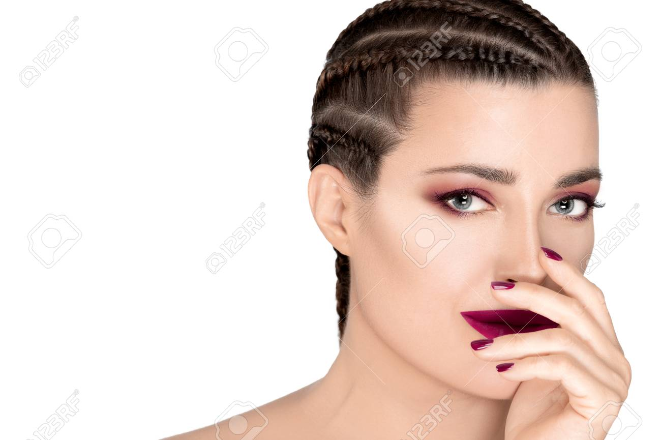 Beautiful young fashion woman with braided hair wearing matching trendy mallow rose lipstick, nail polish and eye shadow. Beauty and makeup concept. Closeup face isolated on white with copy space. - 122865552