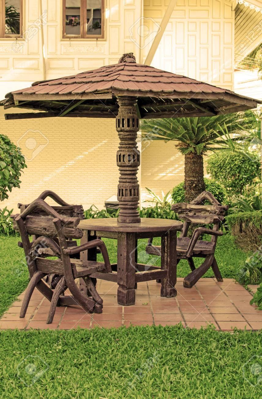Garden Furniture. Chairs And Table Under Wooden Umbrella At Garden ...