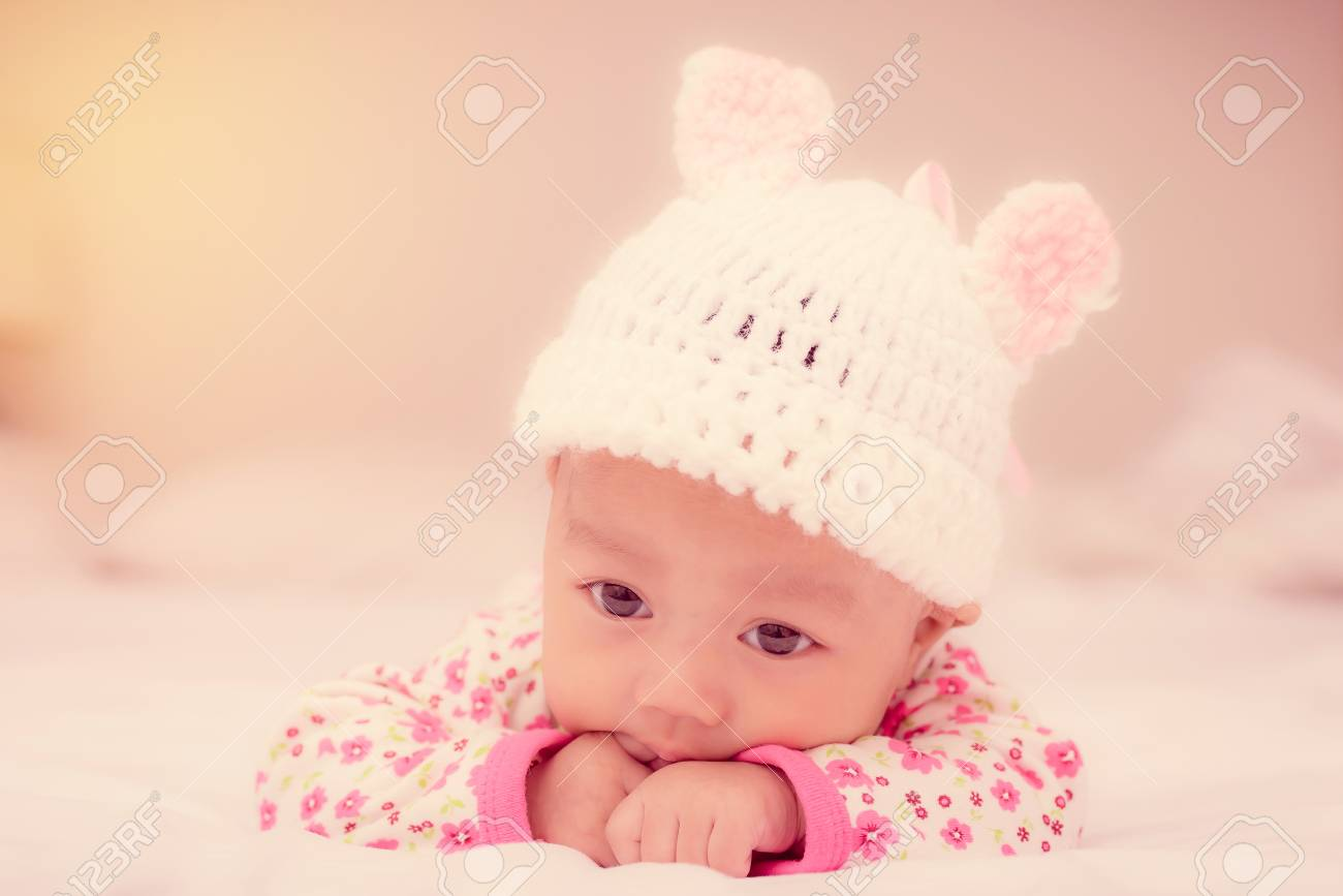 884fd72ef Portrait Of Cute Newborn Baby Girl On The Bed. Stock Photo, Picture ...