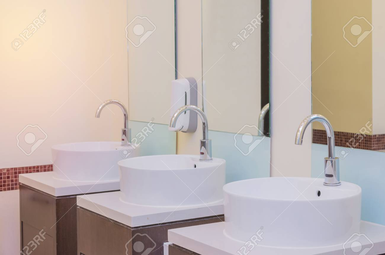 White Basins In Bathroom Interior With Granitic Tiles. Stock Photo ...
