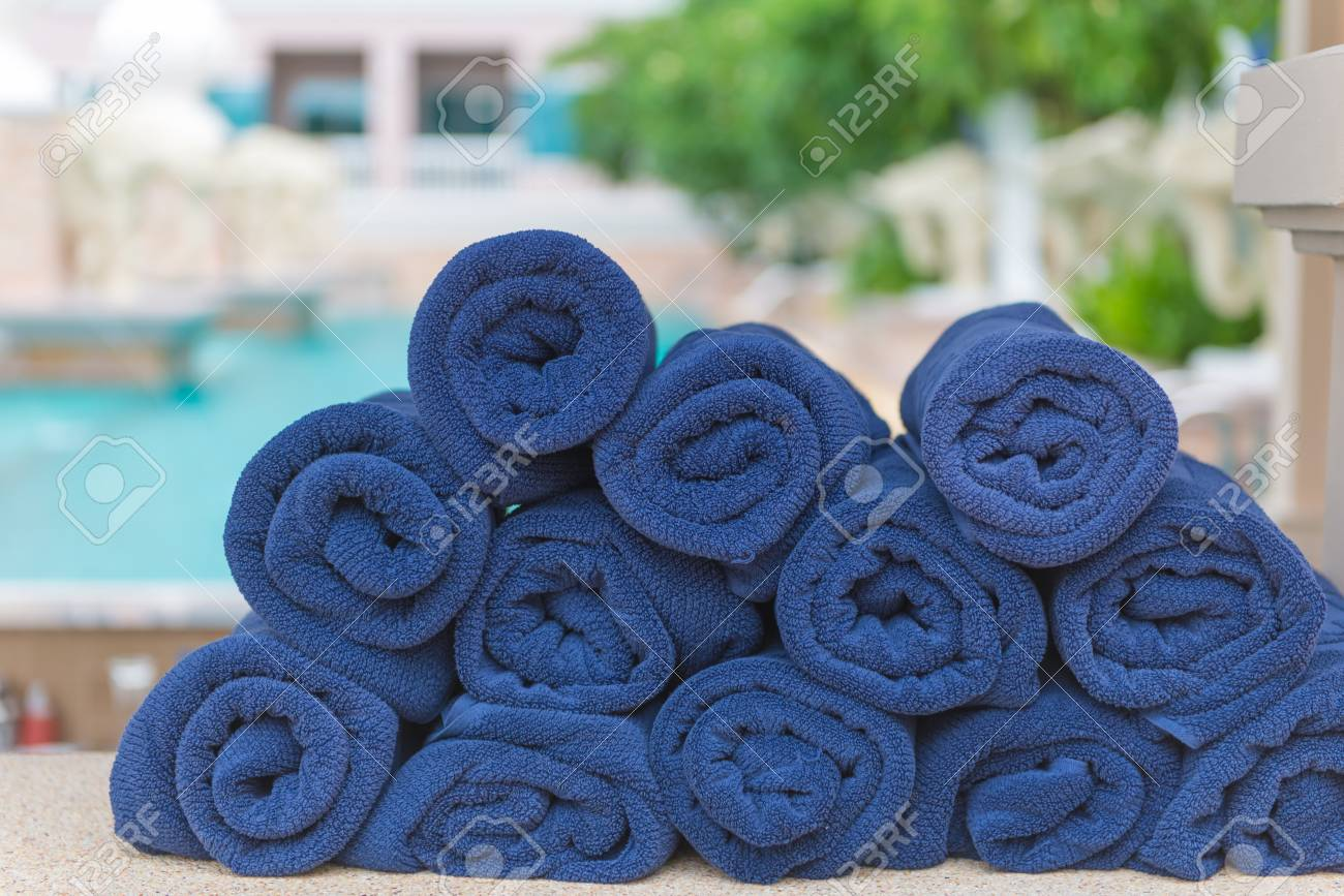 Stack Roll Of Bath Blue Towels On Table At Swimming Pool. Stock ...
