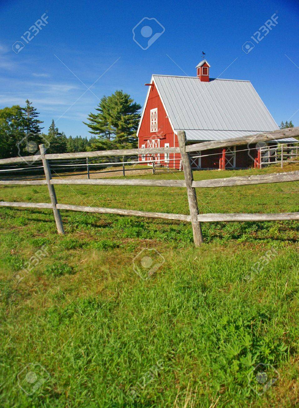 New England red barn and fence against blue sky.Mount Desert Island, Acadia National park, Maine, New England Stock Photo - 7258951