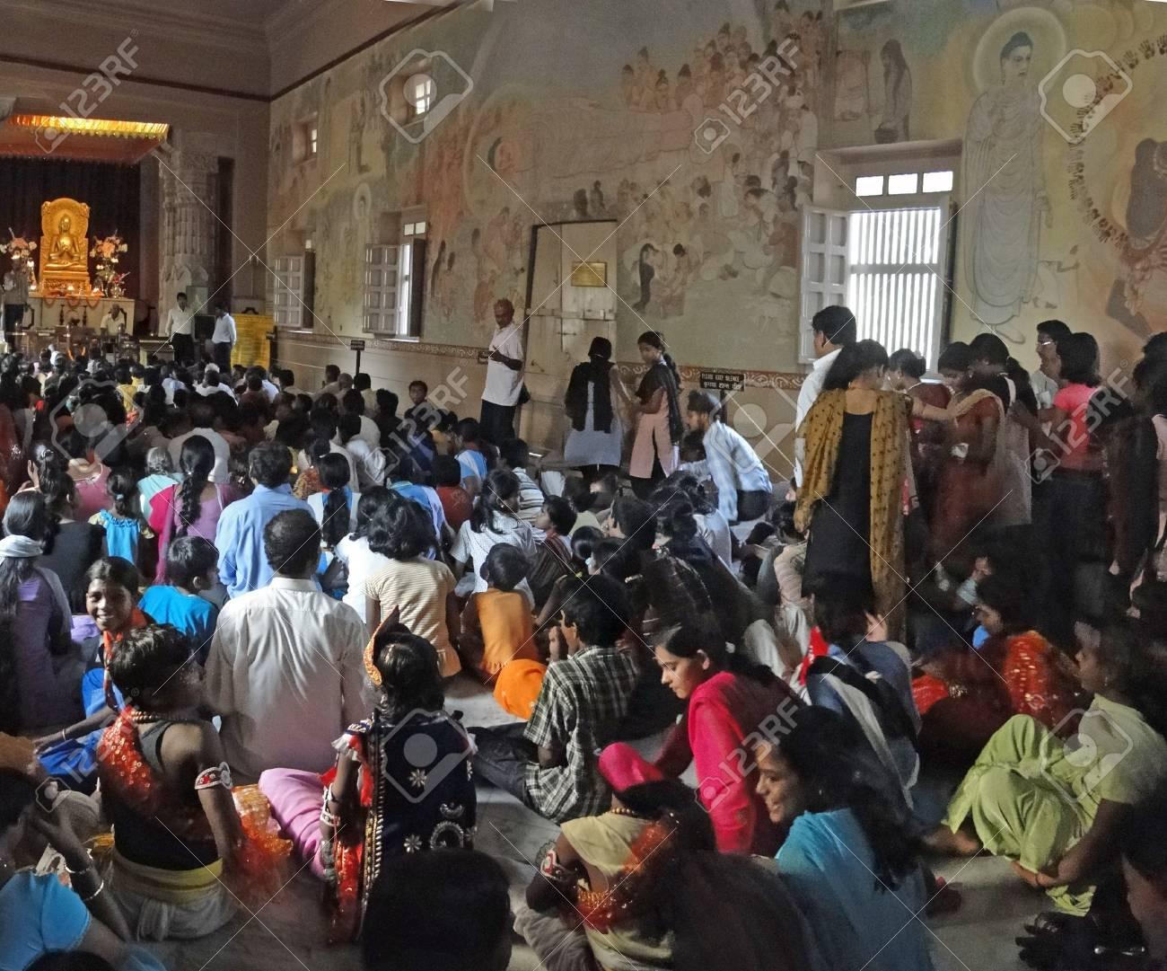 Schoolchildren crowd the interior of the  Mula Gandhkuti Vihara temple Stock Photo - 10007795