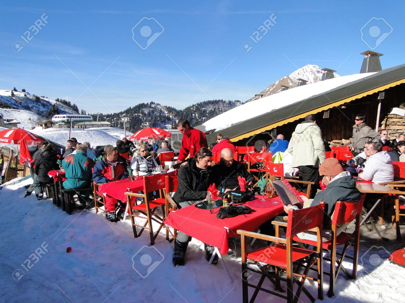 PORTES DU SOLEIL, FRANCE - FEB 10 - Skiers enjoy their lunch on a sunny day  on Feb 10, 2011, near Chatel, France Stock Photo - 10104752