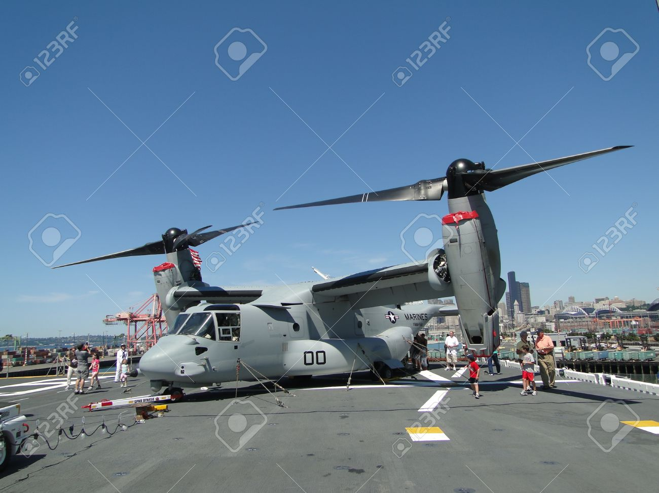 SEATTLE - AUG 4 - Civilians inspect an  MV-22 Osprey,during a tour of the Amphibious Assault Ship Bonhomme Richard, LDH-6,  on Aug 4, 2011, in Seattle. The Osprey is a military, tiltrotor aircraft with both a vertical takeoff and landing (VTOL) and short  Stock Photo - 10530180