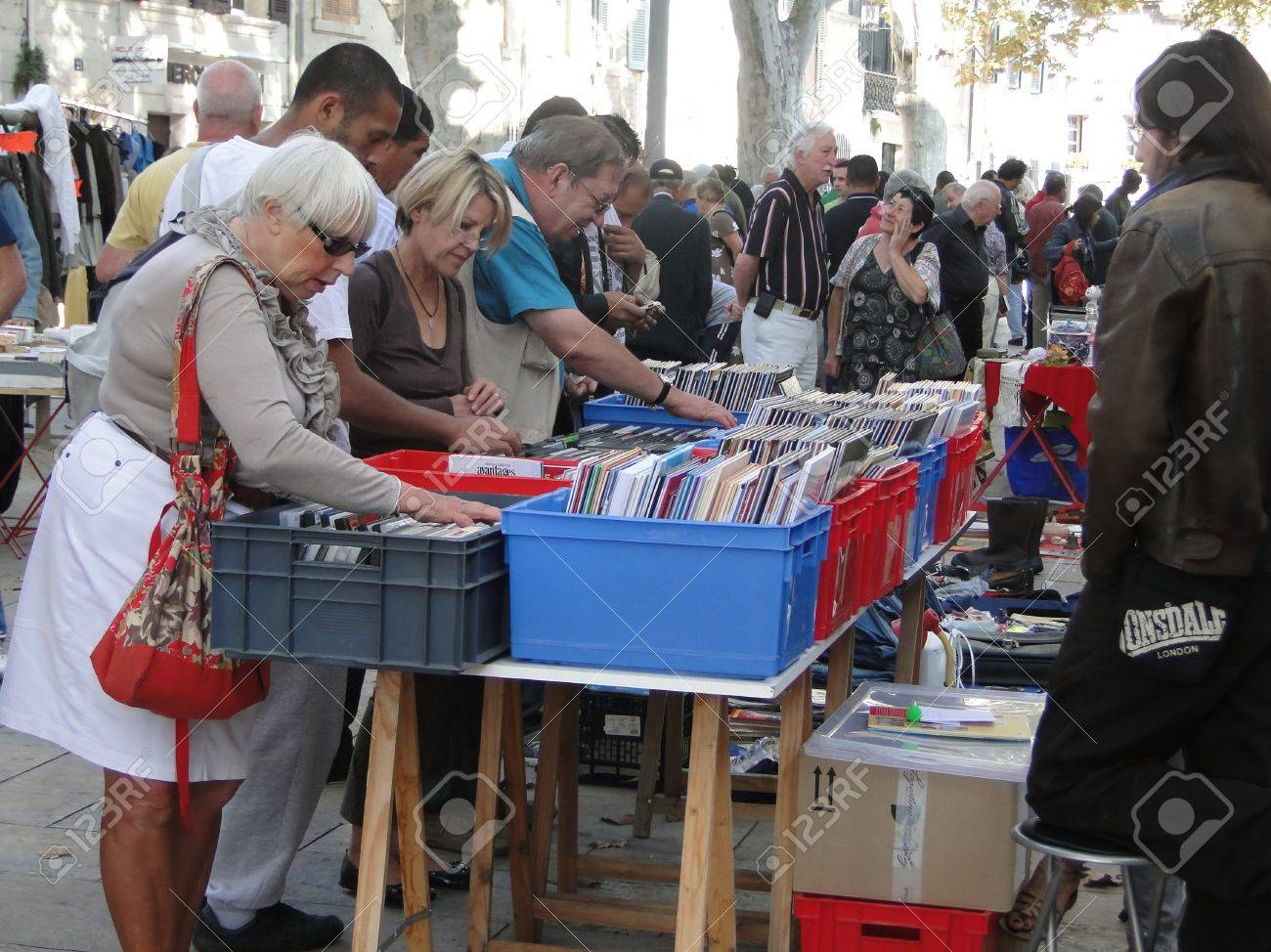 AVIGNON, FRANCE - OCT 2:Shoppers search for bargains at a weekly flea market on Oct 2, 2011, in Avignon, France. - 11501848