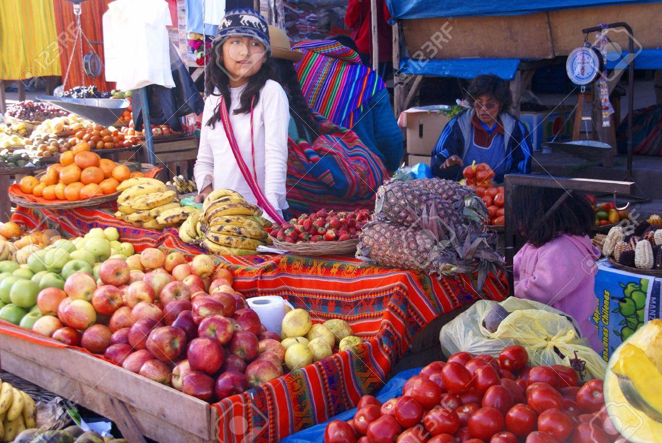 Indian girl selling vegetables, Pisac market, Cusco, Peru, South America - 11501873