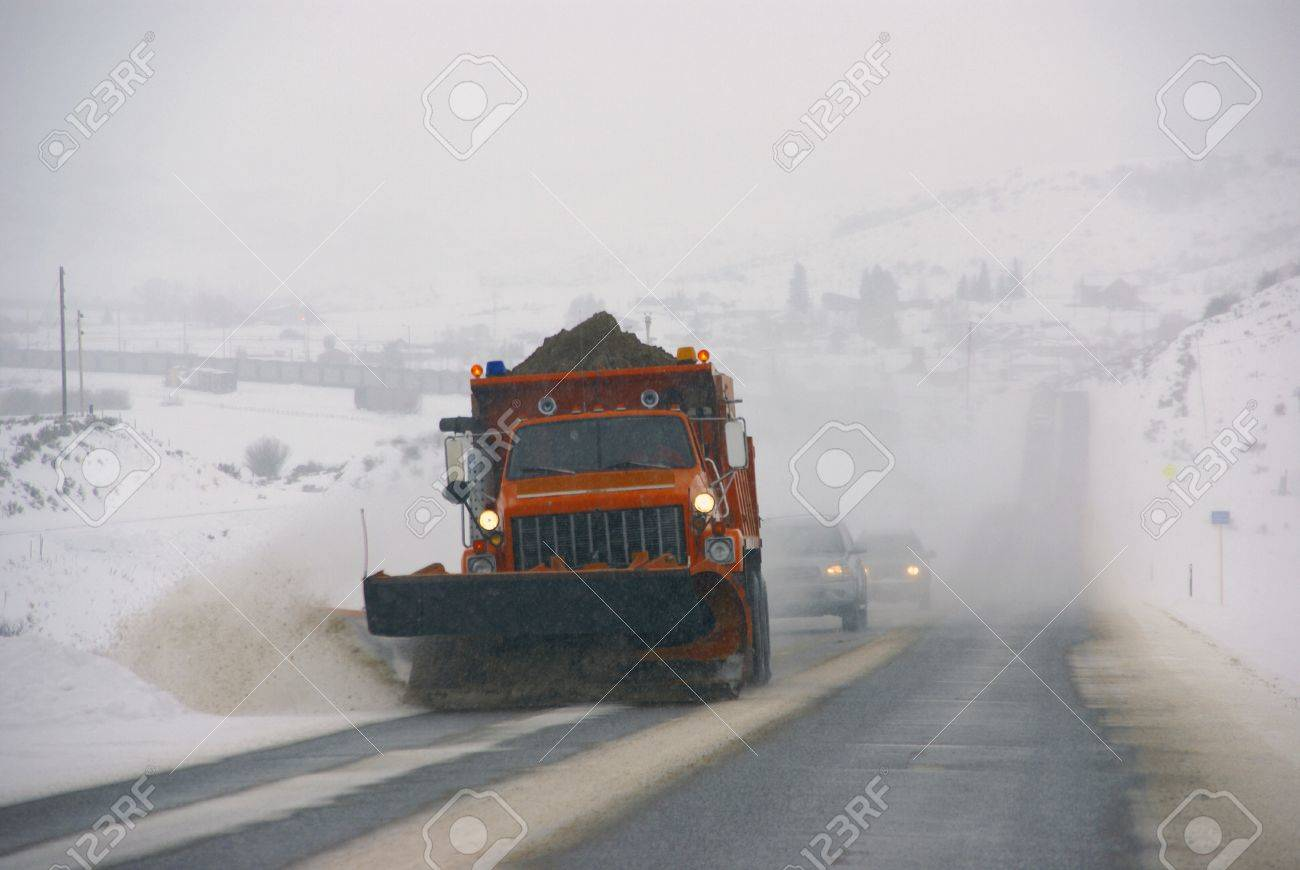 Snowplow clearing streets after heavy snowfall,		Steamboat Springs,	Colorado, Rocky Mountains