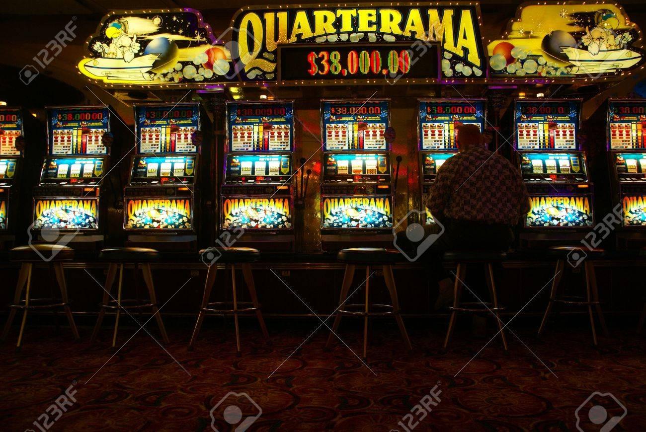 Lone man playing video slot machines,Cruise ship casino,Pacific Northwest - 11786052