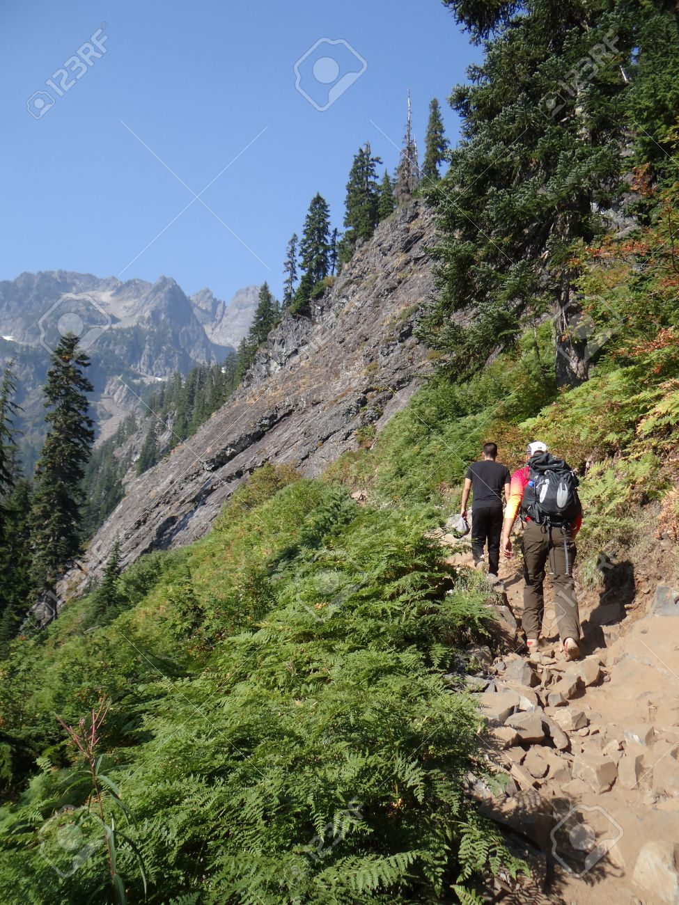 Hikers climbing steep mountain trail with switchbacks near Snoqualmie