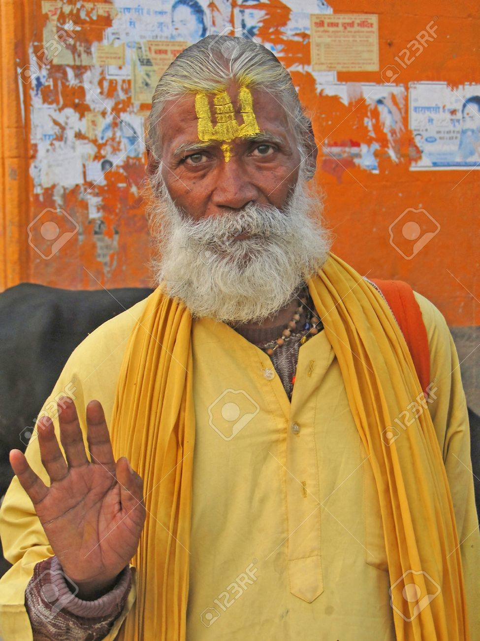 VARANASI, INDIA - NOV 6 -  Hindu Sadhu gives blessings on the bathing ghats on Nov 6, 2009,  in Varanasi, India.         Stock Photo - 15927473