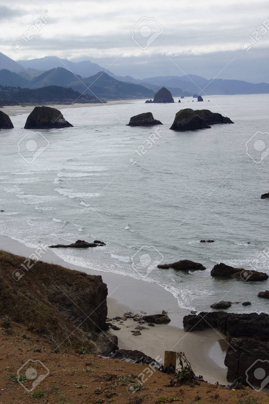 Sea Stacks And Misty Mountains With Weather Front Moving Onshore Near Cannon Beach Oregon Coast