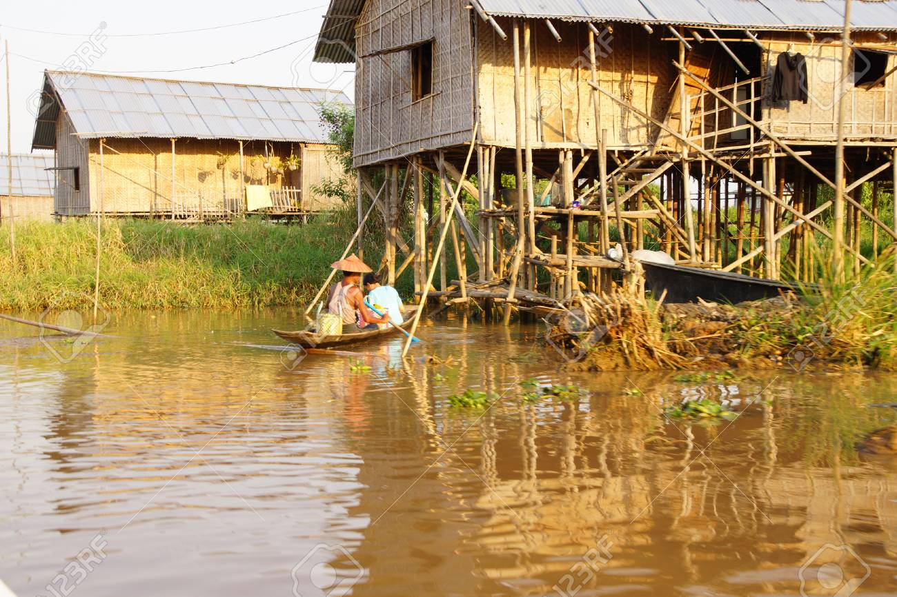 Small Boat Among The Floating Gardens And Canals Of Inle Lake ...