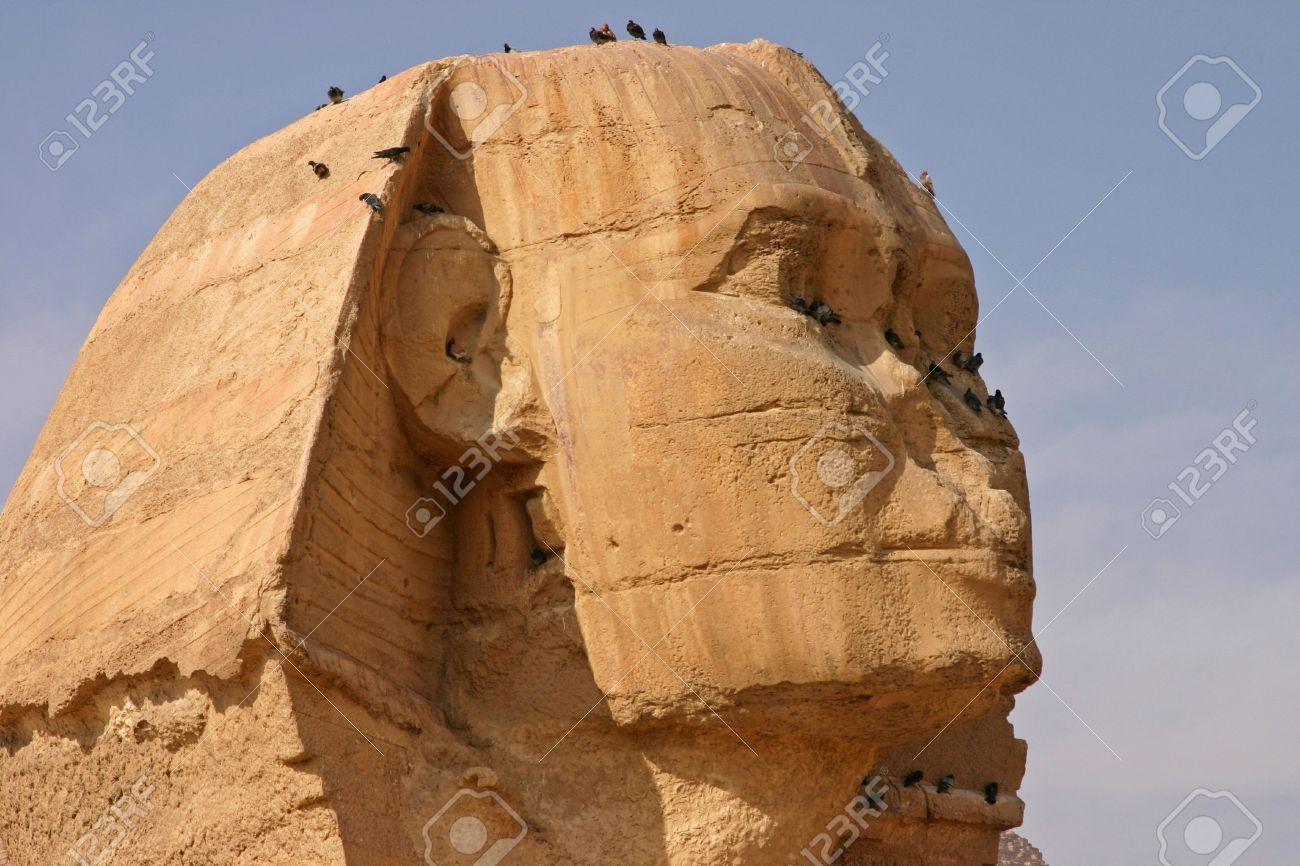 [Image: 3342408-Face-of-the-Sphinx-with-birds-on...-Photo.jpg]