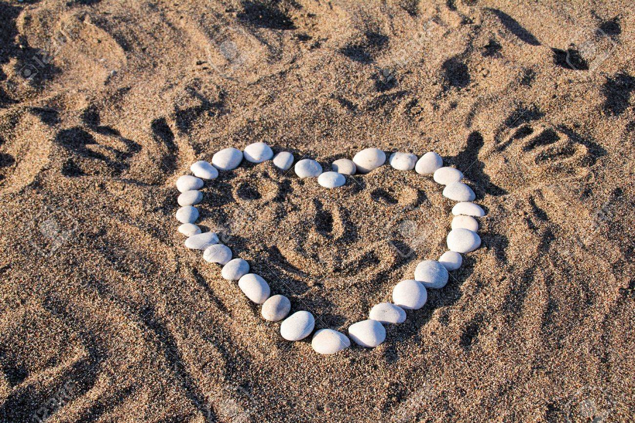 Funny heart on the beach sand Stock Photo - 12980601