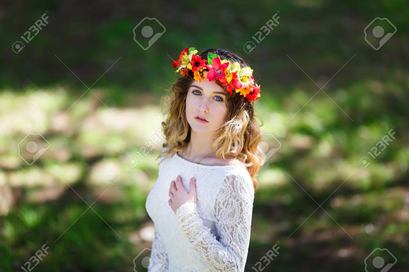 Portrait of a beautiful girl with flowers in her hair at spring portrait of a beautiful girl with flowers in her hair at spring time stock photo izmirmasajfo