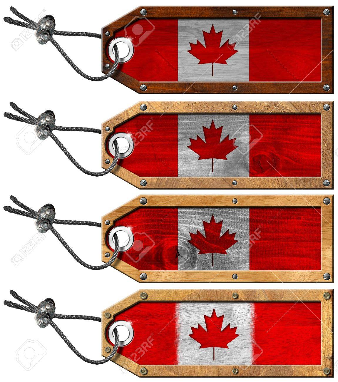 Four grunge wooden tags with Canada flags, steel cable and metal rivets Stock Photo - 16821244