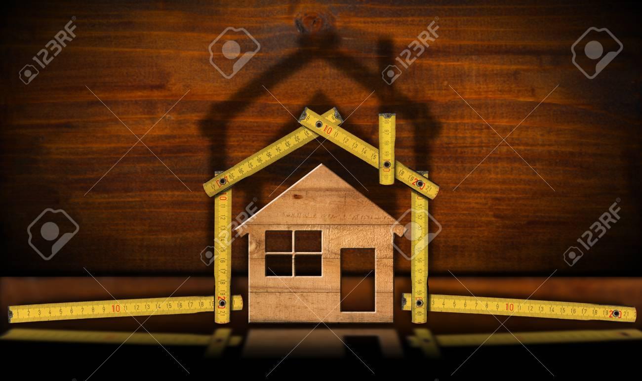 Concept de lindustrie de la construction règle en forme de maison