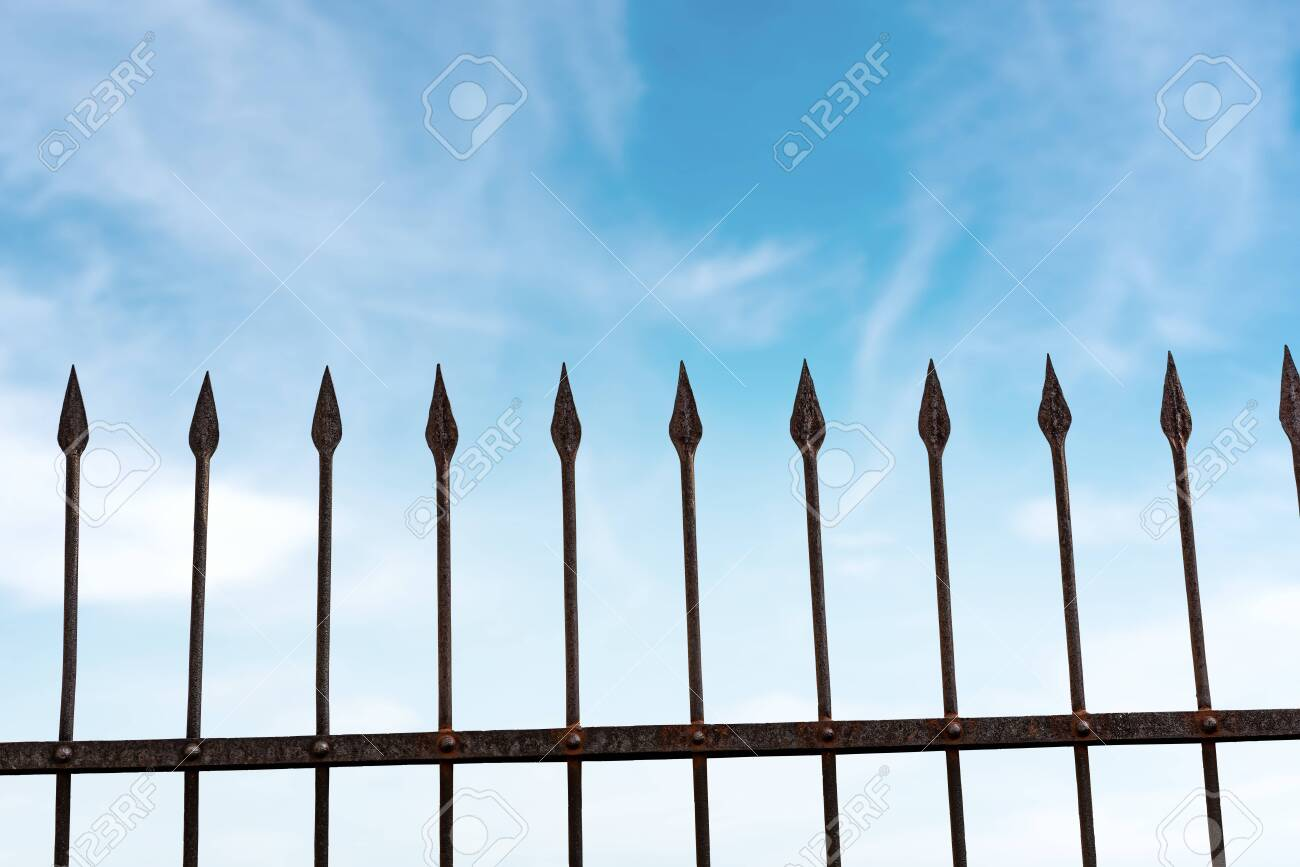 Close Up Of A Wrought Iron Fence With Sharp Points On Blue Sky Stock Photo Picture And Royalty Free Image Image 141681692