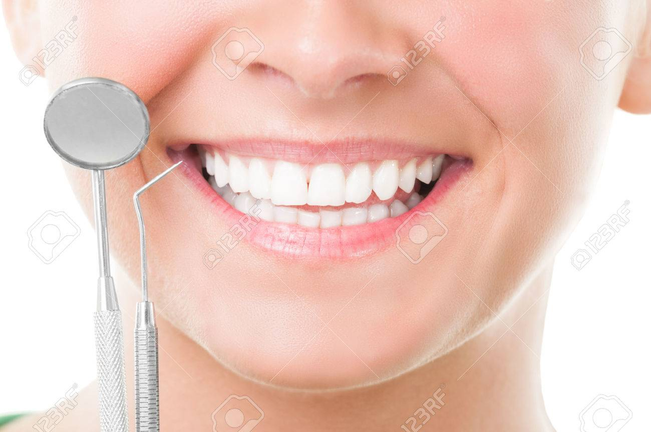 Closeup of perfect smile and dentist tools on white background - 32791311