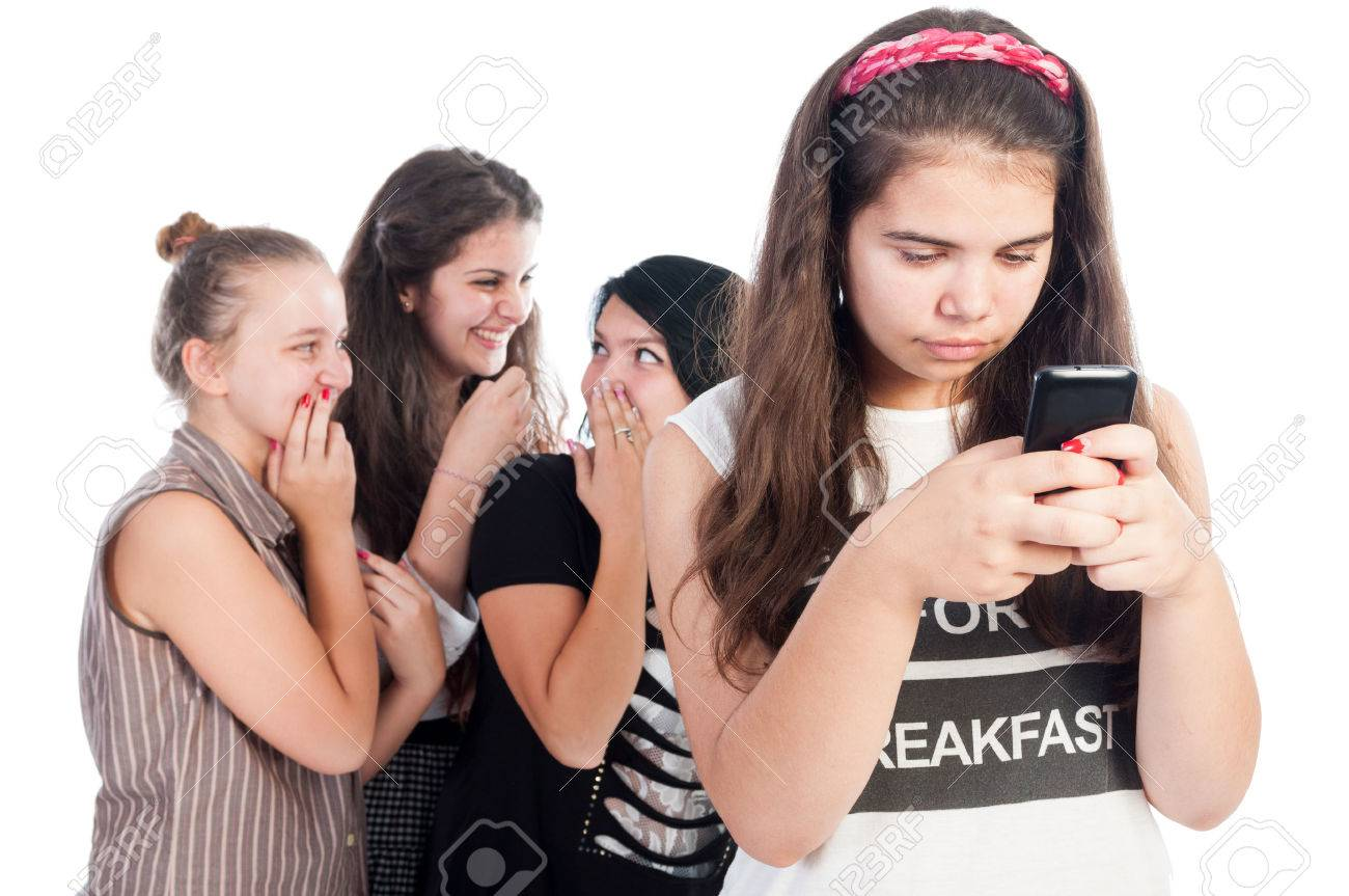 Mean and bullying teen girls on white background - 35102623