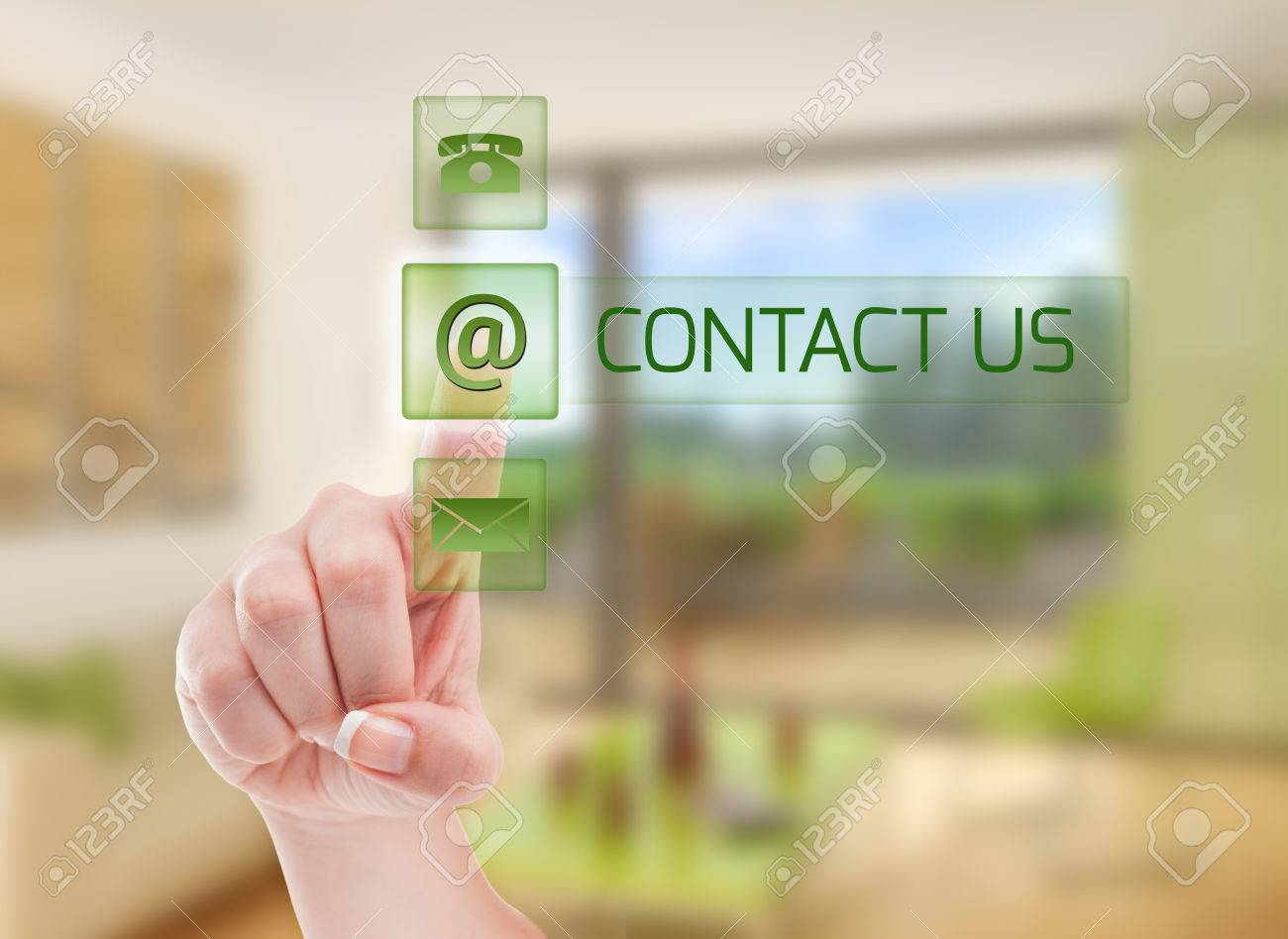 Contact real estate agency futuristic concept using a woman pressing a button on transparent screen with house interior as background - 35160433