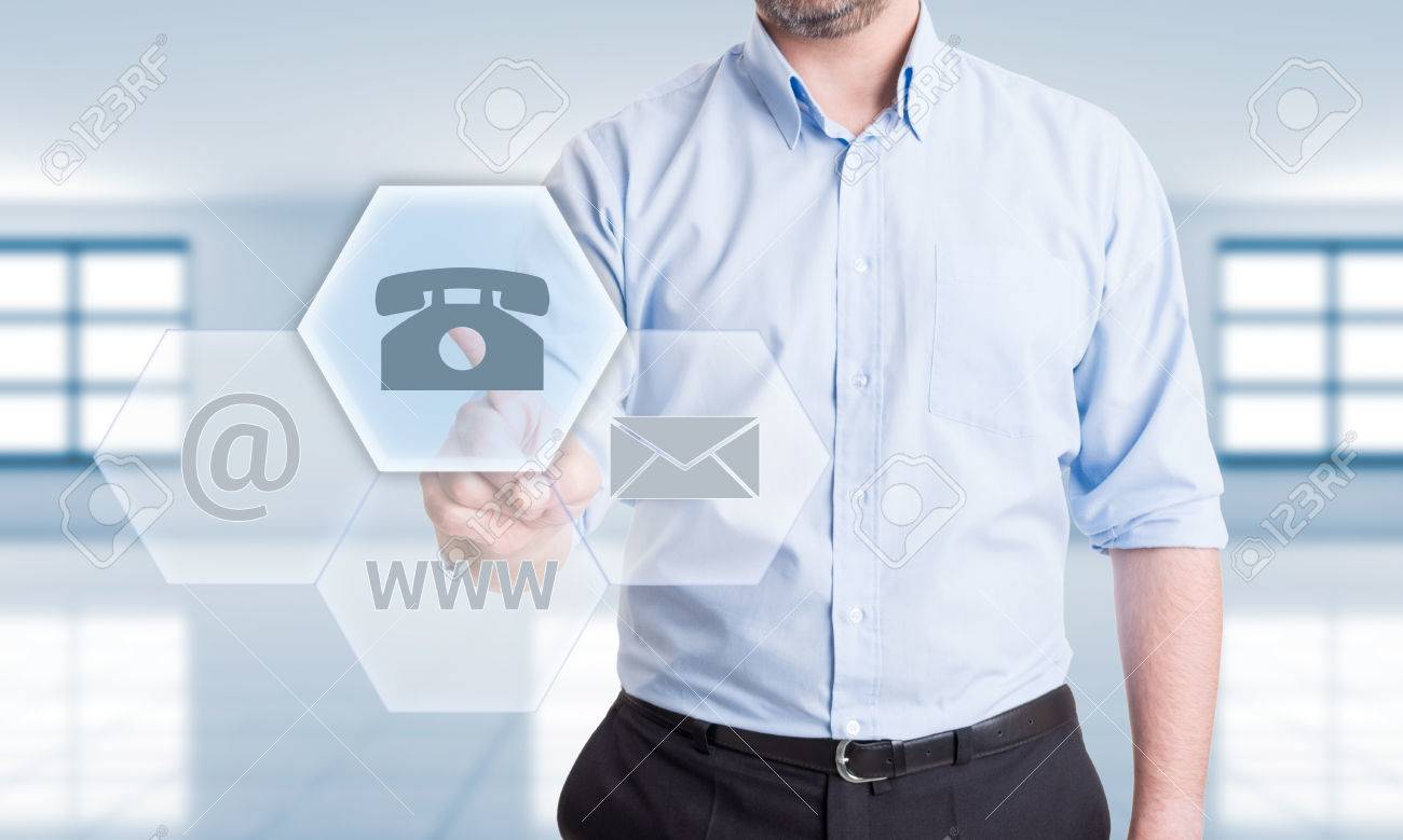 Contact us using phone concept with man pressing button on transparent futuristic touch screen - 40216019