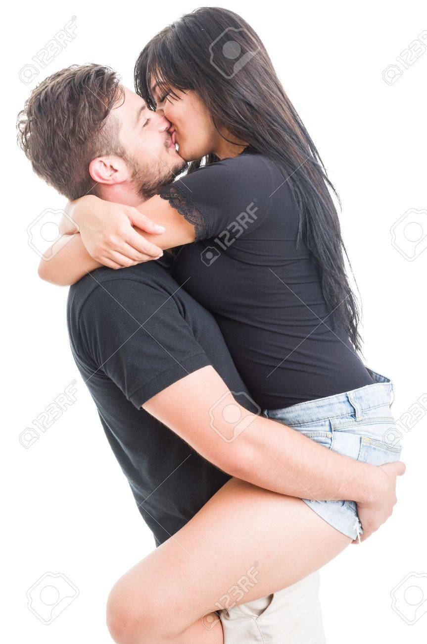 handsome boyfriend holding and kissing happy girlfriend on white