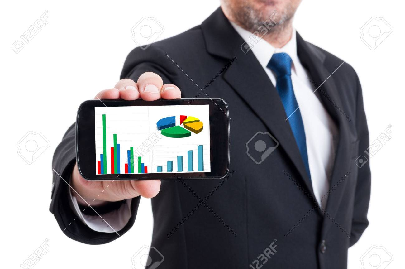 Marketing manager holding smartphone with growing financial chart and piechart isolated on white - 43003608