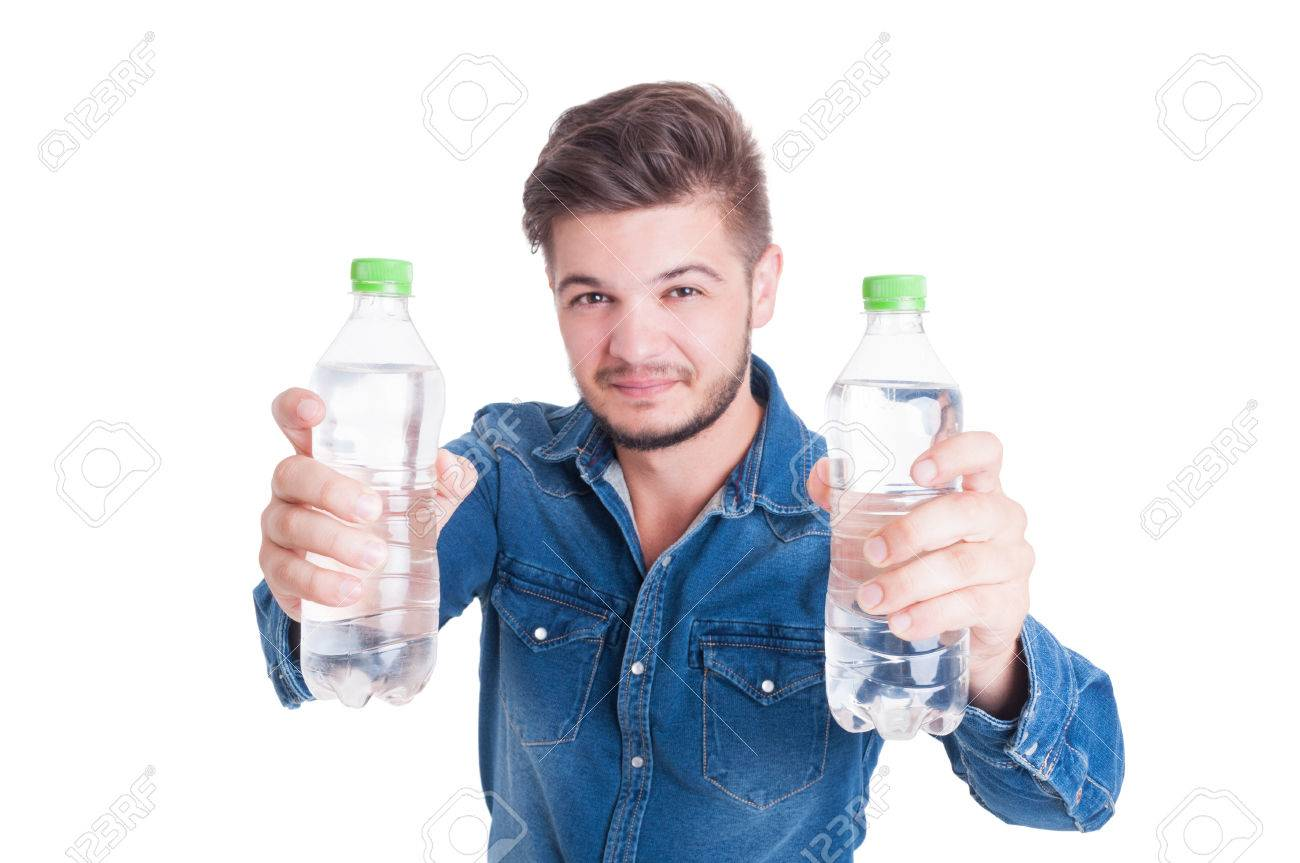 Handsome male model holding two bottles of cold water in summer heat season as dehydration concept - 43237519