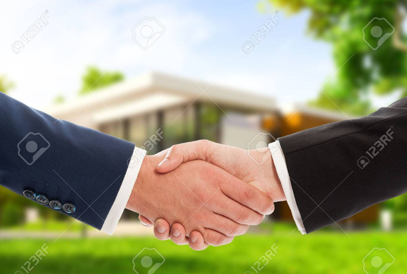 Handshake on house outdoor background as real estate deal or sale concept - 43613225