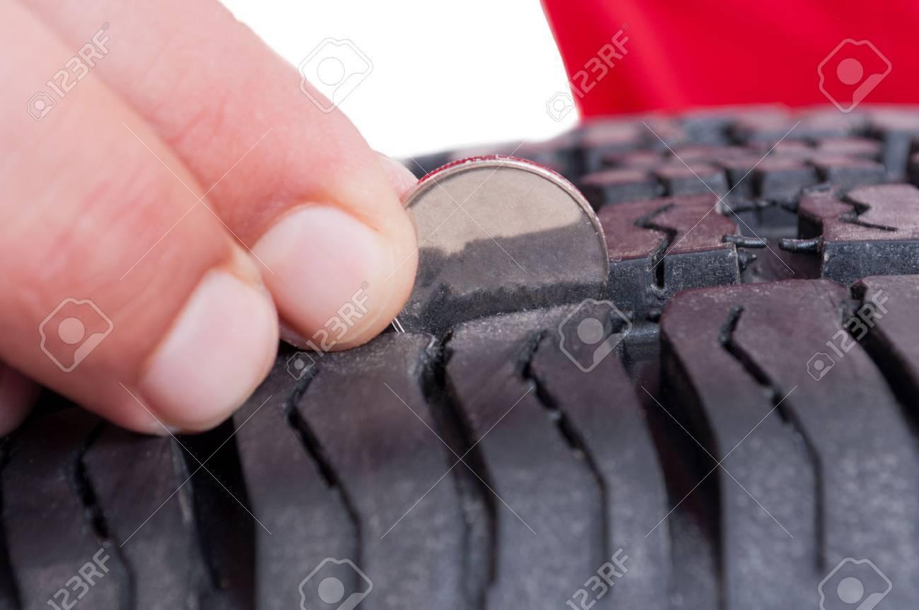 Car wheel tire depth check with coin concept - 43613468
