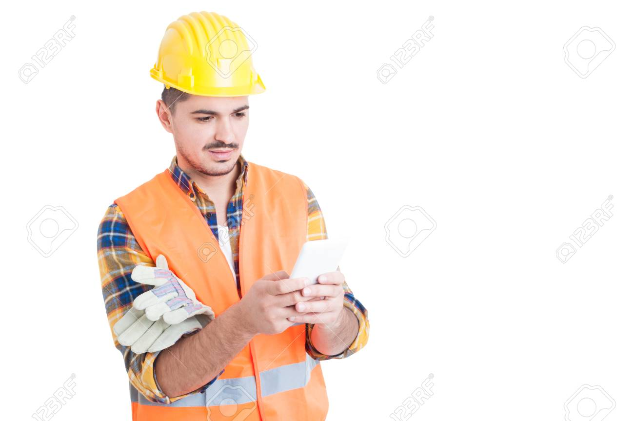 Handsome engineer typing something on his white smartphone isolated on white with copy space - 54583949