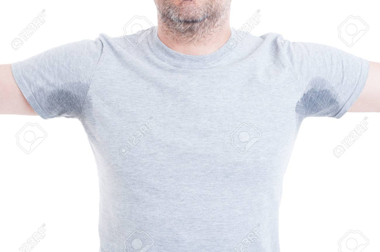 Man with both arms raised and excessive sweat stains on grey t-shirt isolated on white as hyperhidrosis concept - 57658413