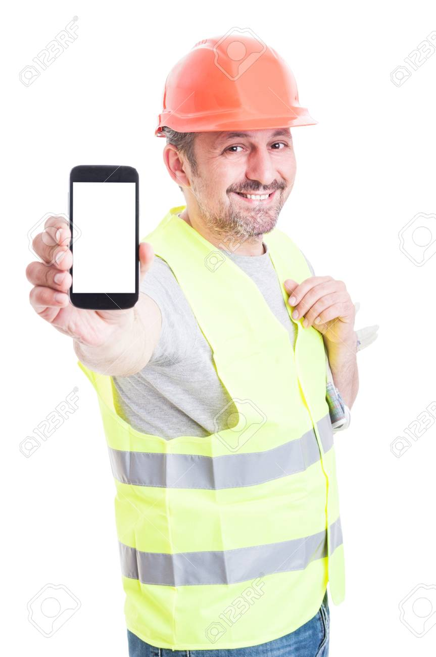 Smiling attractive builder holding modern smartphone with blank screen and copyspace isolated on white studio background - 59598723