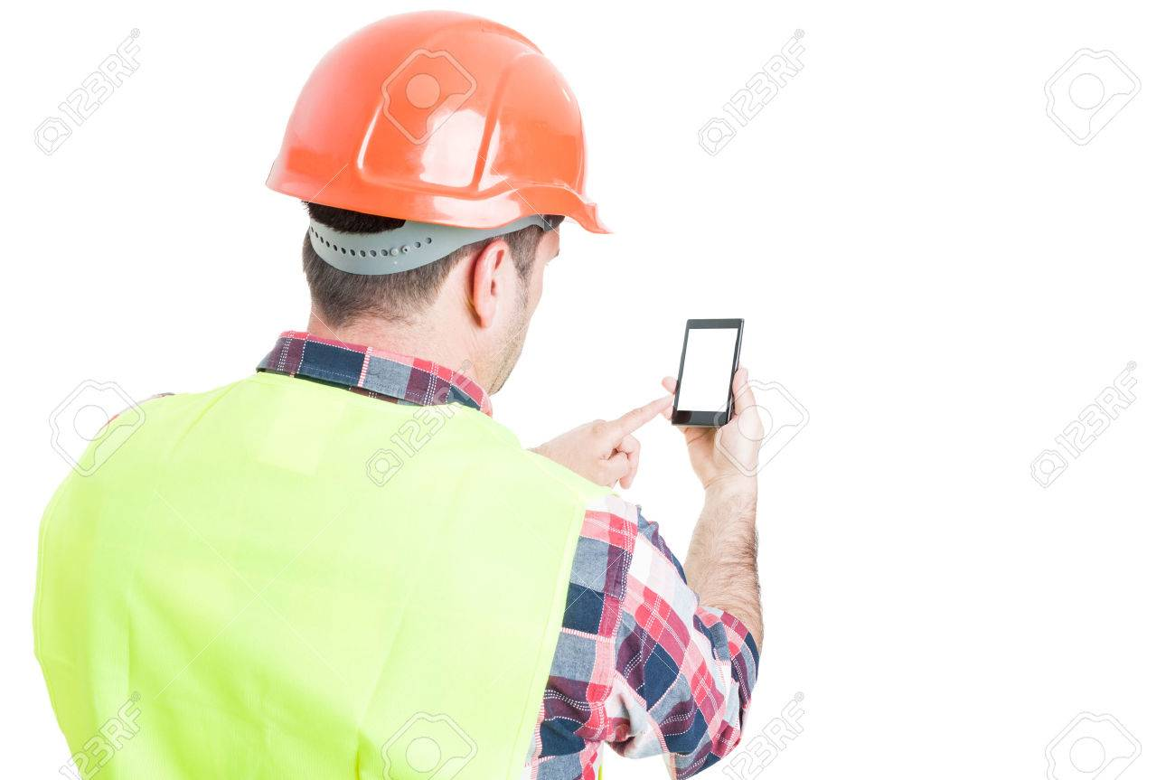 Backview of male engineer holding mobile phone with blank screen and copyspace isolated on white - 60386585