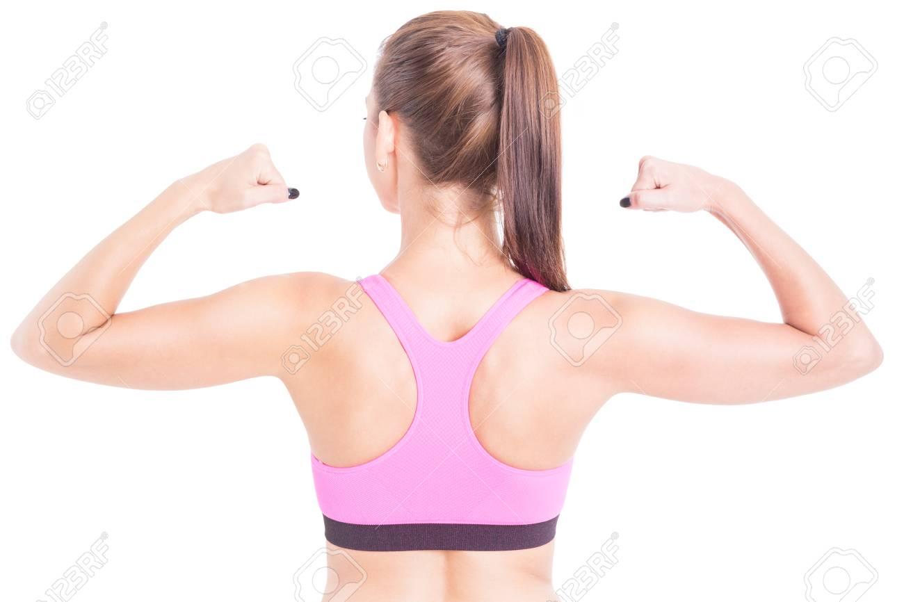 Fit Frau Zeigt Ihren Rücken Und Bizeps Muskeln Rosa Bustier Getrennt ...