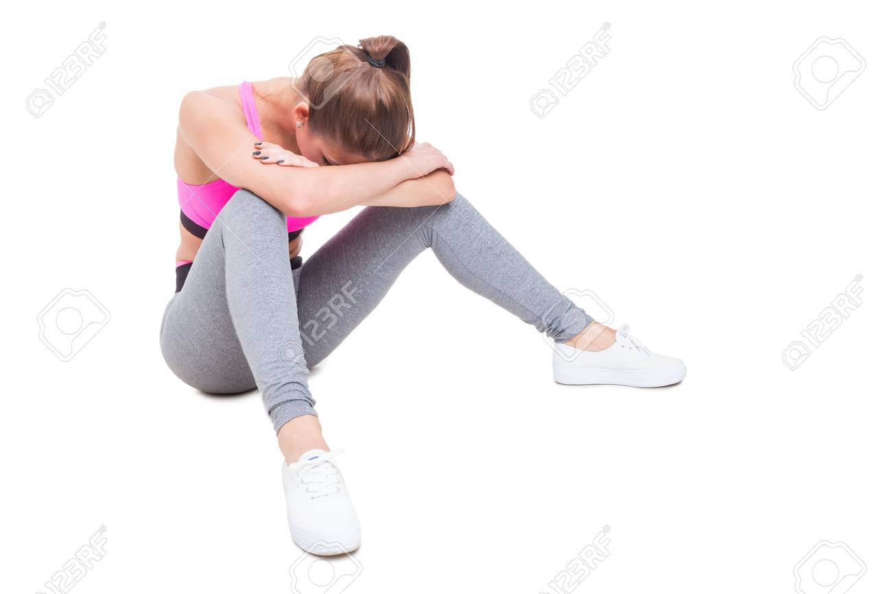 Fit young female siting tired after workout isolated on white background with copy text space - 61154265