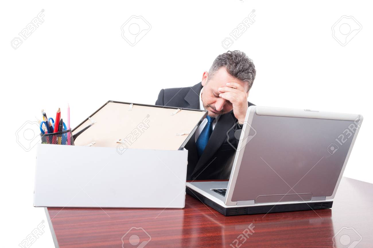 man at office with his personal stuff box being upset as being