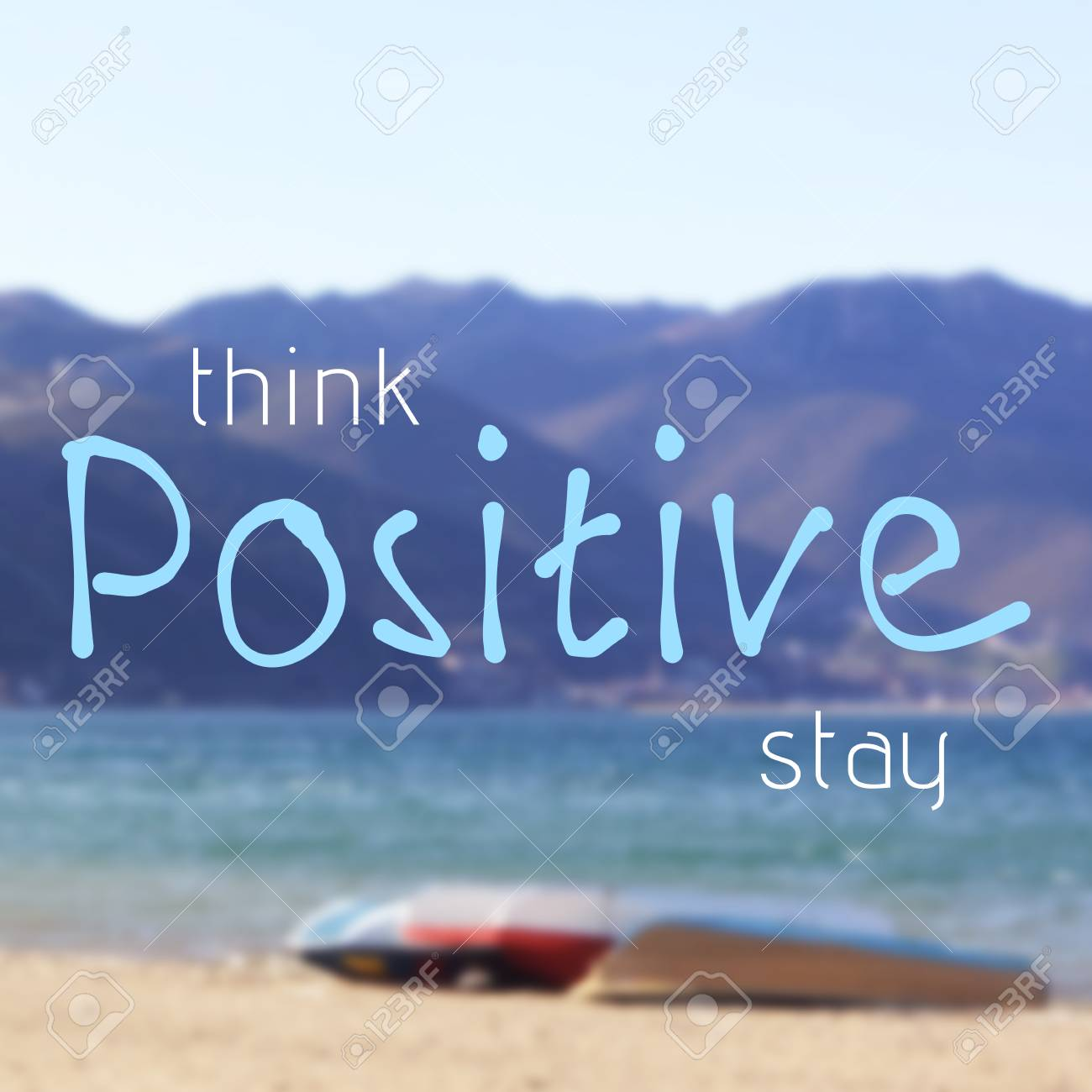 Think and stay positive inspirational quote on blurred background..