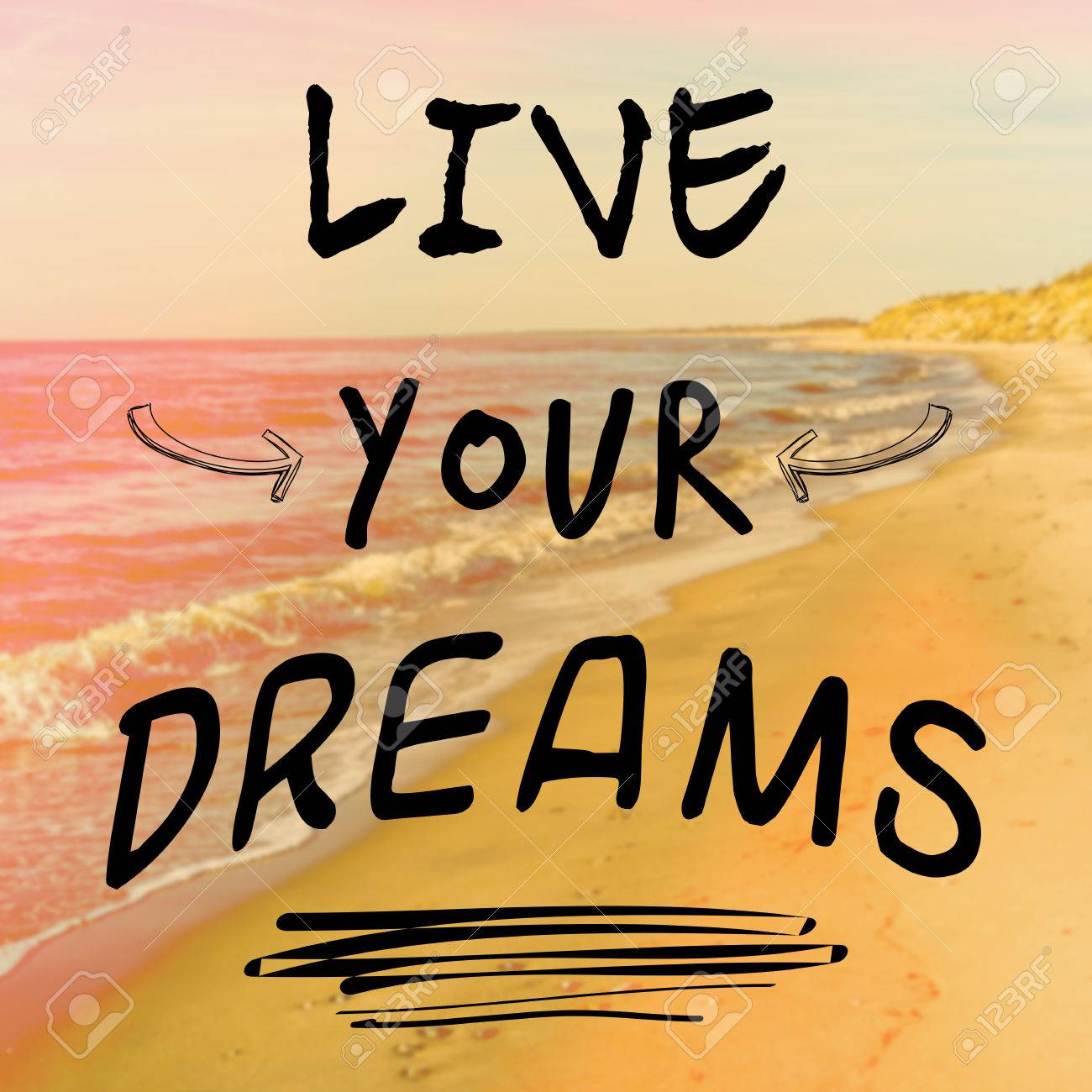 Motivational Quote With Phrase Live Your Dreams On Background With Sea And  Sand Stock Photo