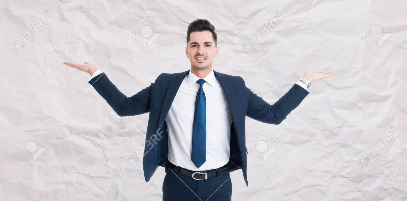 Handsome male manager with palms up holding something invisible