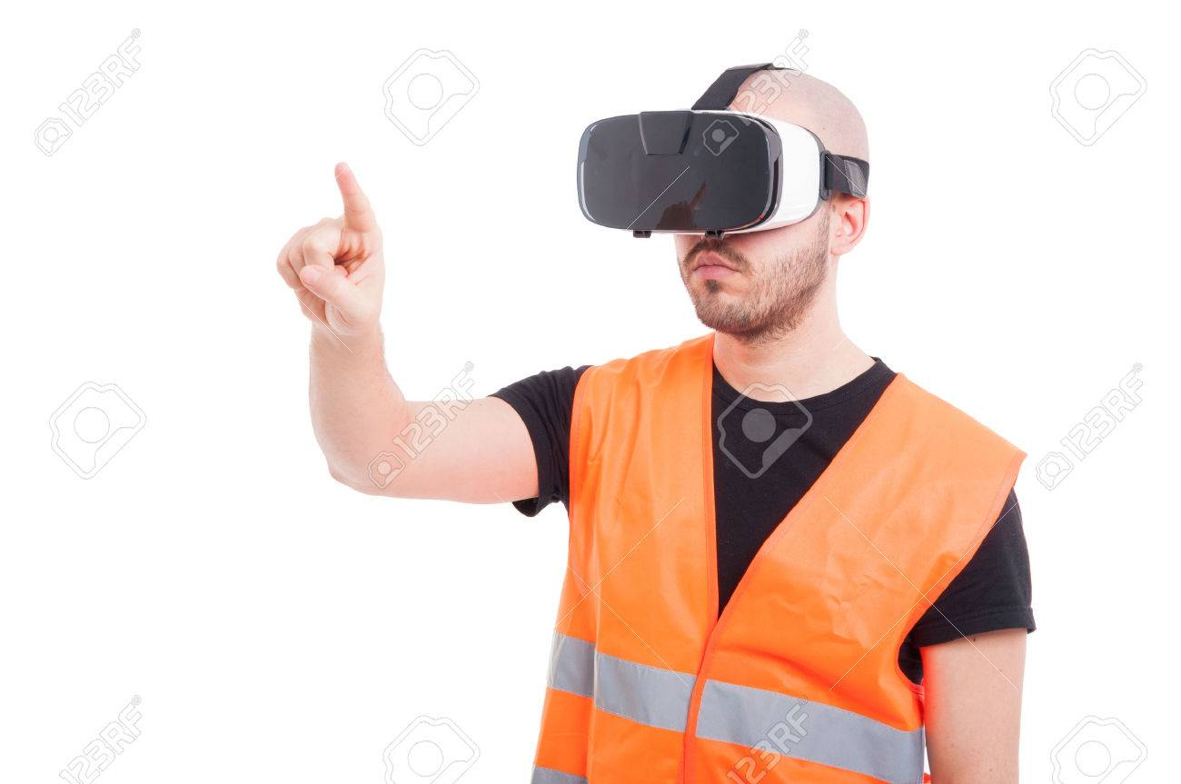 Male engineer pressing on virtual screen while looking thru virtual goggles isolated on white - 72068482
