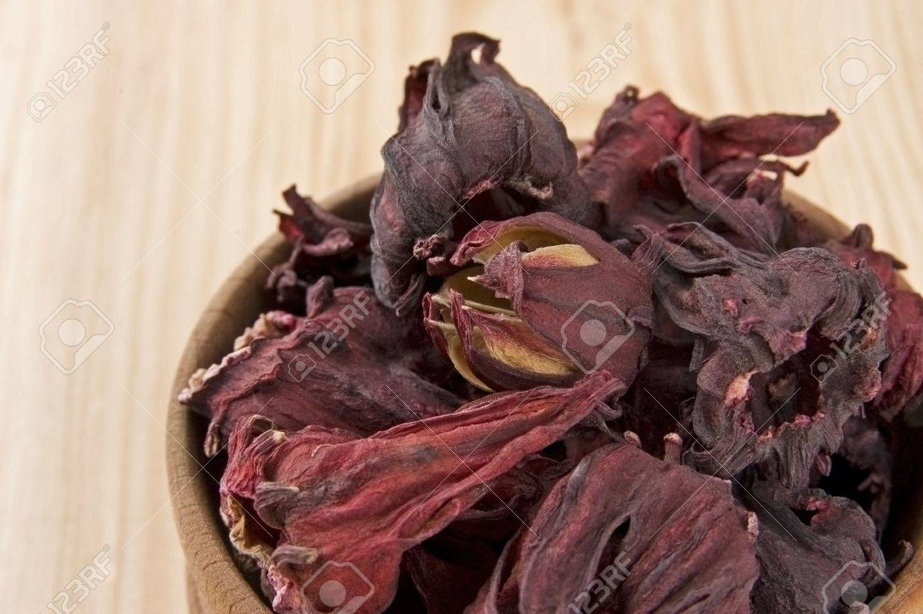 Dry hibiscus tea flowers in wooden bowl close up stock photo dry hibiscus tea flowers in wooden bowl close up stock photo 19982576 izmirmasajfo Images