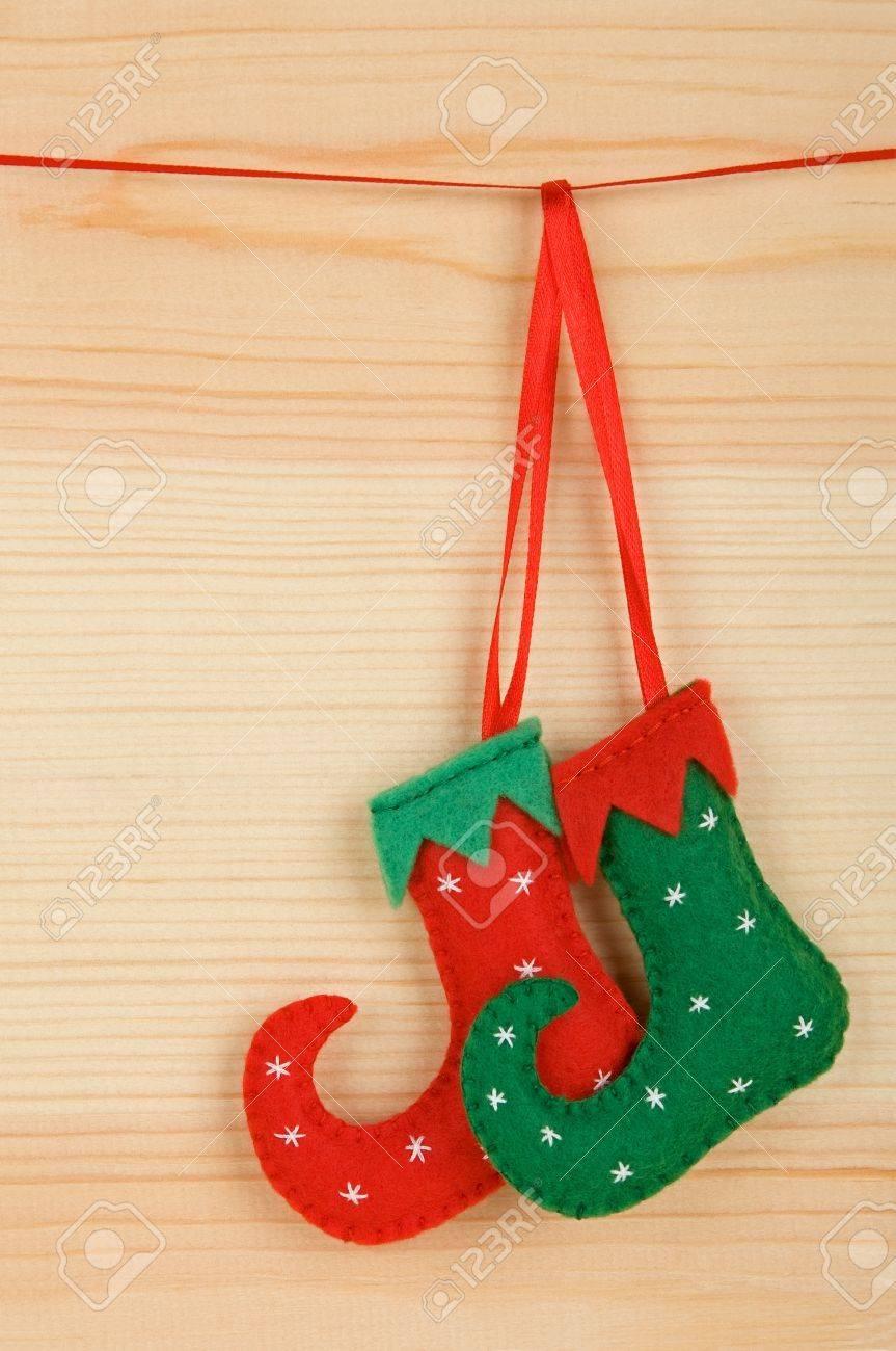 Handmade Christmas Decorations Felt Elf Shoes Over Wooden Background