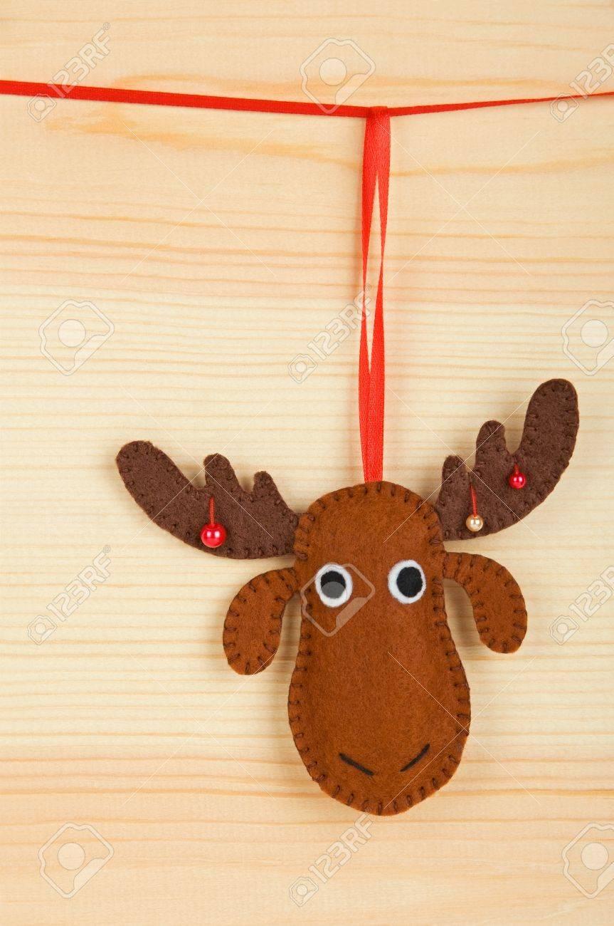 Handmade christmas decorations felt christmas moose over wooden