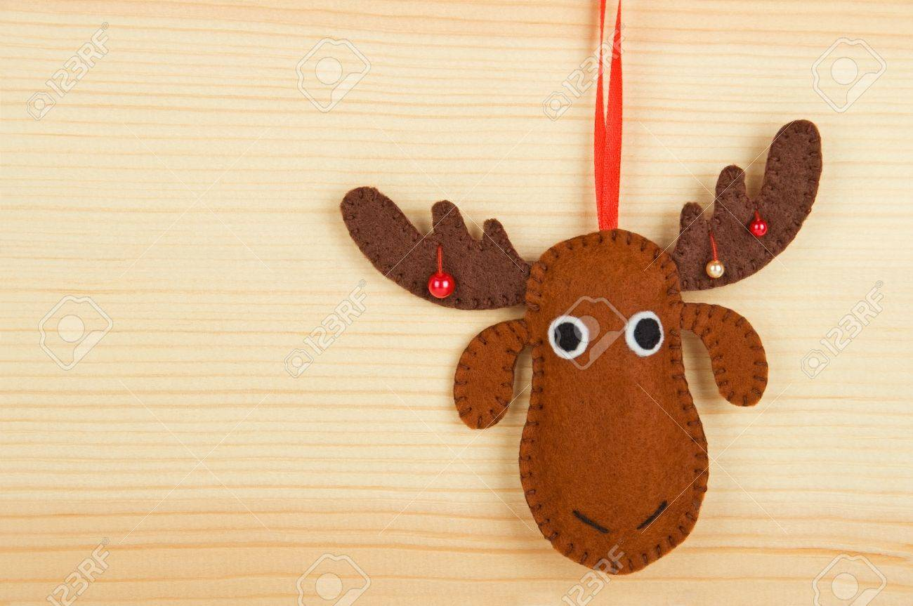 handmade christmas decorations felt christmas moose over wooden background stock photo 21395708